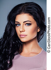 Cute fashion model with healthy skin and hair