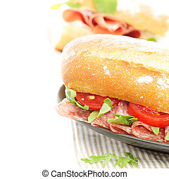 Snack food sandwich with salami and tomatoes