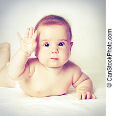 Baby with hand up