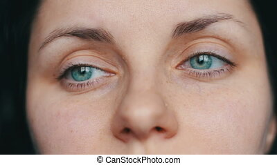 Close up view of a beautiful girl with green eyes smiling...