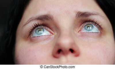 Close Up Of Young Woman's Eyes As She Smiles, Her Hair is...