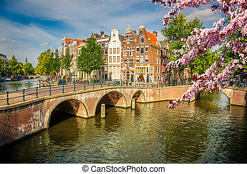 Amsterdam at spring - Bridges over canals in Amsterdam at...