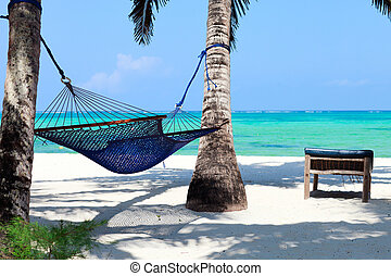 Perfect tropical paradise beach of Zanzibar island with palm...