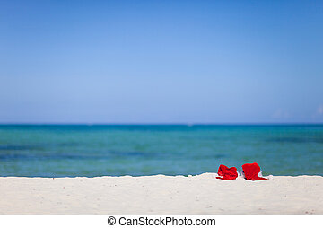 Two santa hats on beach - Two red santa hats on tropical...