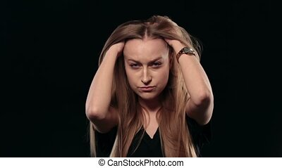 Young stressed woman thinking over problem - Portrait of...