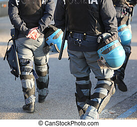 Italian police in riot gear with flak jackets and protective...