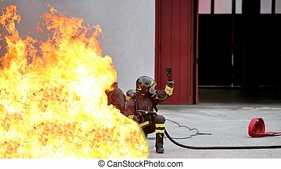 firefighters during the exercise for the fire extinguishing...