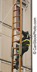firefighter over a wooden stairs during a fire-fighting...