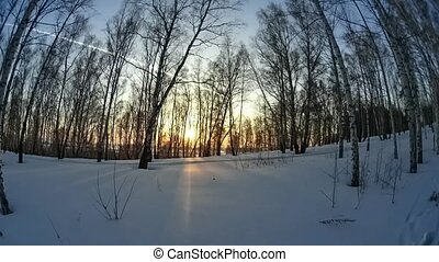 Tim lapse setting sun on a background of snowy valley - Tim...