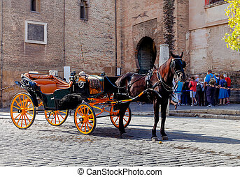 Sevilla. Tower Giralda. - Horse-drawn carriage near the...