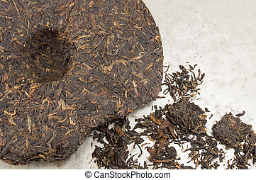 Pu-erh fermented Chinese tea in a roll