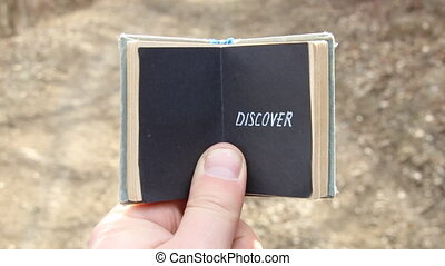 DISCOVER or travel, traveler, trip concept - guy holding a...