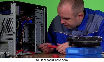 Skilled computer repairer man replace hard drive and plug...