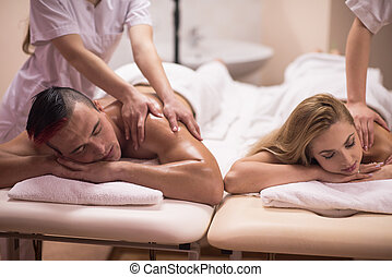 couple receiving a back massage