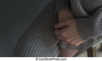 Hand of woman sitting on chair