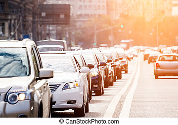Traffic on the road with evening sun - Congested lane with...