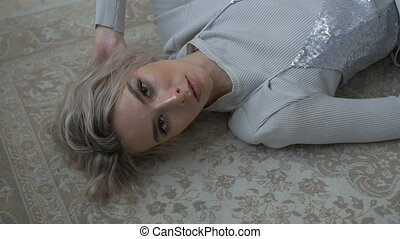 Pretty female lying on the floor