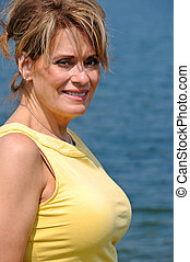 Attractive Mature Woman by the Lake