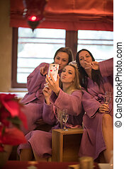 girls doing Selfy on bachelorette party - three young...