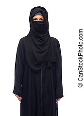muslim woman in hijab over white background - religious and...