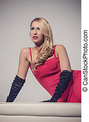 Seductive blonde woman in red dress