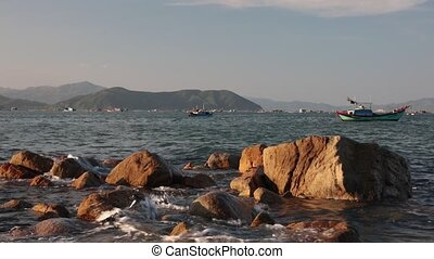 Ocean With Sound Vietnam - A rocky coastline fishing port...