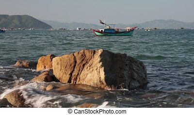 Ocean Scene With Sound Vietnam - A rocky coastline fishing...