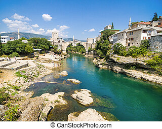 People at Old Bridge over Neretva river in Mostar, Bosnia...