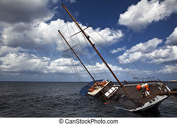 Sinking Schooner - A schooner listing to its side and slowly...