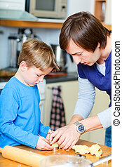 Father and son baking together - Portrait of father and son...