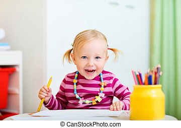 Toddler girl drawing with pencils - Cheerful toddler girl...