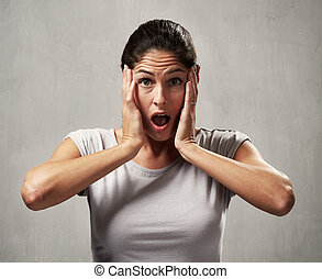 surprised afraid woman - Surprised shocked young woman face...