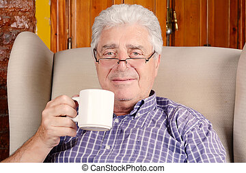 Old man drinking coffee. - Portrait of an old man having a...
