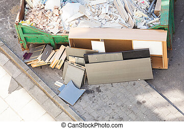 Bulky waste, messy trash in container, mess after...