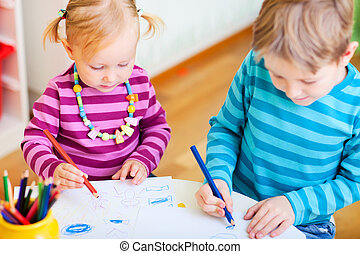 Brother and sister drawing in their room - Brother and...