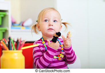 Toddler girl playing with finger toys