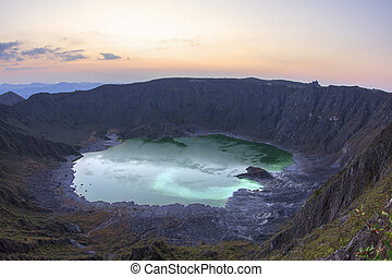 Green sulfuric lake in volcanic crater - Acidic green...