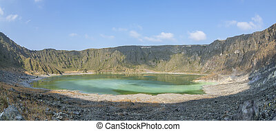 Green acidic sulfuric lake in volcano crater - Panoramic...