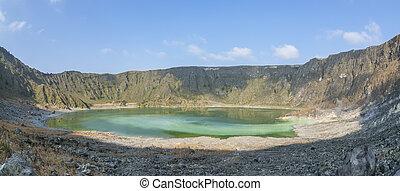 Green acidic sulfuric lake in volcano crater - Panoramic...