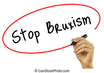 Man Hand writing Stop Bruxism with black marker on visual...
