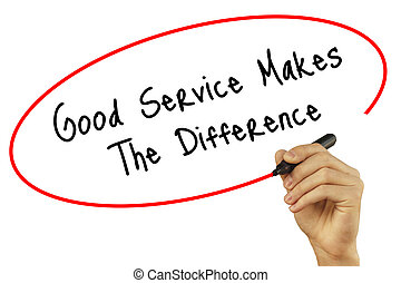 Man Hand writing Good Service Makes The Difference with black marker on visual screen. Isolated on background. Business, technology, internet concept. Stock Photo
