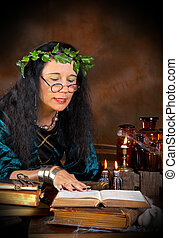 Book of shadows - Halloween witch reading in her book of...