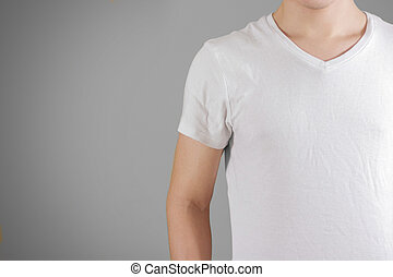 White t shirt on a young man template on gray. Isolated on grey background.