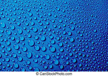 Water drops on the blue background