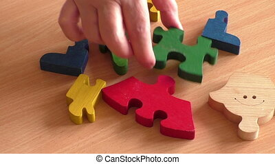 Hands that build wooden puzzles