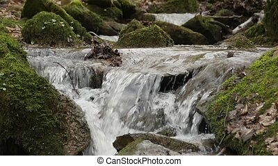 slow motion shot of a river flow / waterfall - A slow motion...