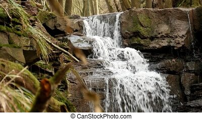 shot of a river flow / waterfall - A slow motion shot of a...
