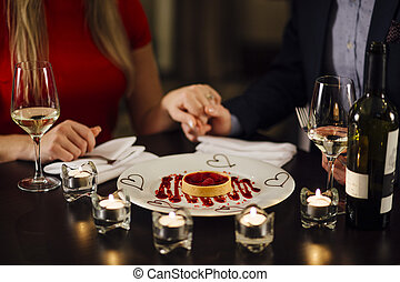 Valentine's Day Dessert - Couple are in a restaurant on...