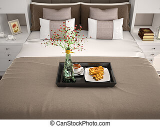 Breakfast in bed. Flowers in a vase and wafers with...
