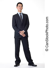 Handsome business man of Asian, full length portrait.
